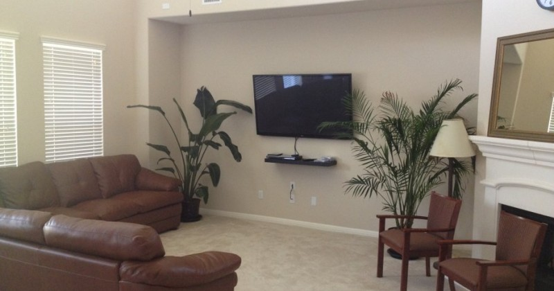 The two-story downstairs living room has a 60 inch plasma TV and the upstairs living room has a 55 inch plasma TV